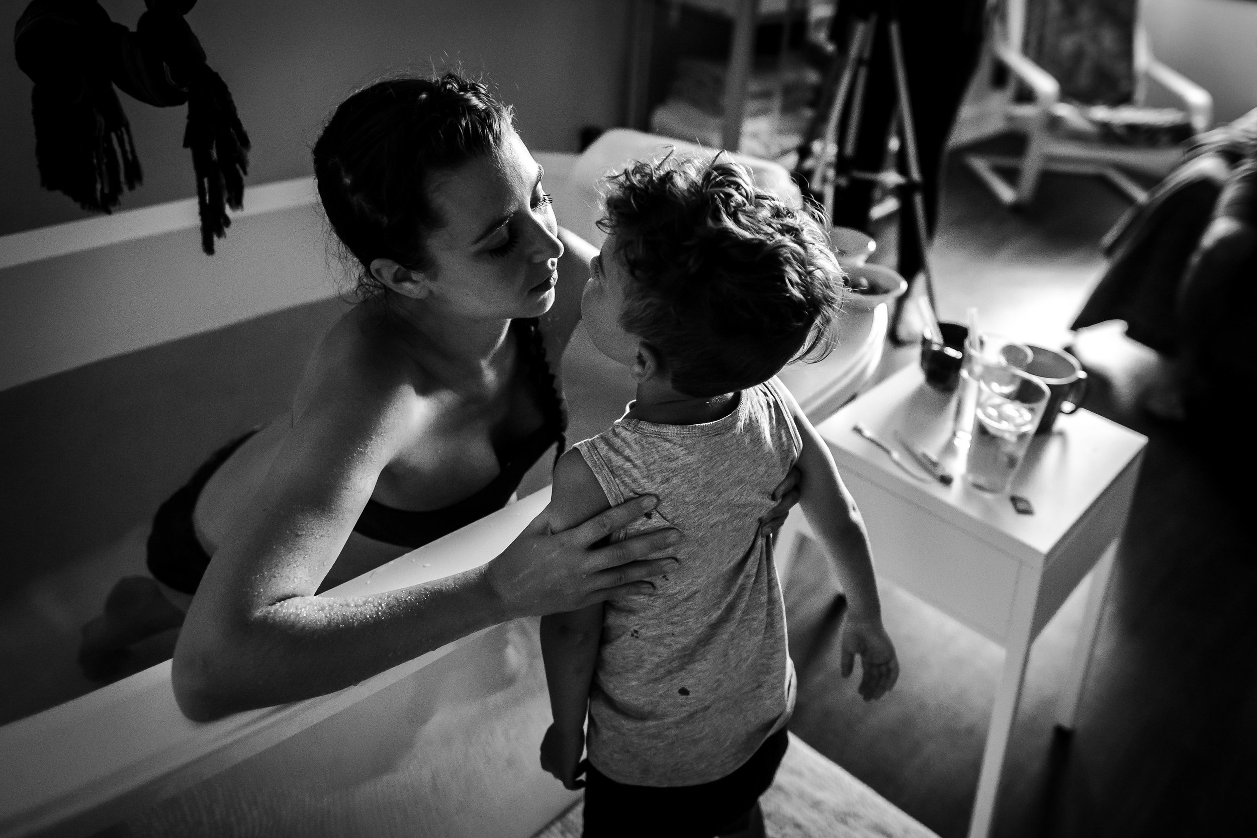 Adele embraces her older son just before the next wave came...image taken at the Birth Center of Boulder.