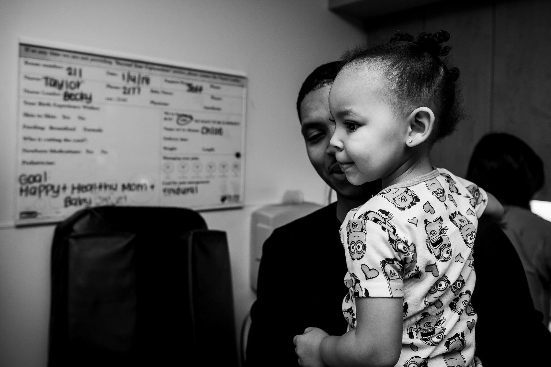 big-sister-watches-newborn-exam