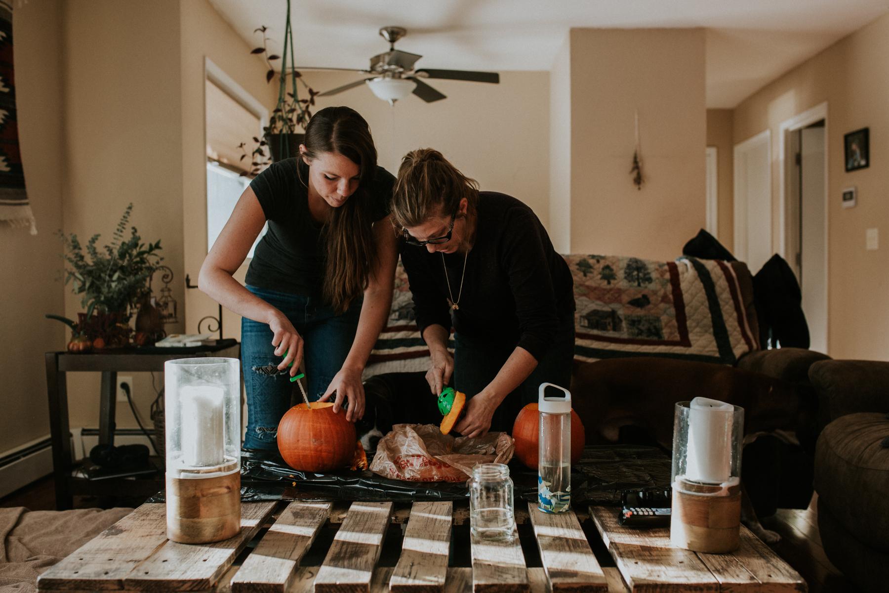 Carving pumpkins in livingroom