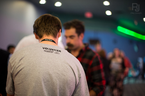 The CIFF is heavily dependant on their great volunteers. Here is a photo of one taking the ticket from a beautiful-bokeh moustachioed patron.