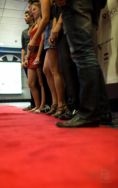 You would not believe how hard it is to make a photo of people's shoes standing on a red carpet without looking like you're trying to take up-skirt shots...well you might believe it. I assure everyone, especially those in the above photo, that is not what I was doing.