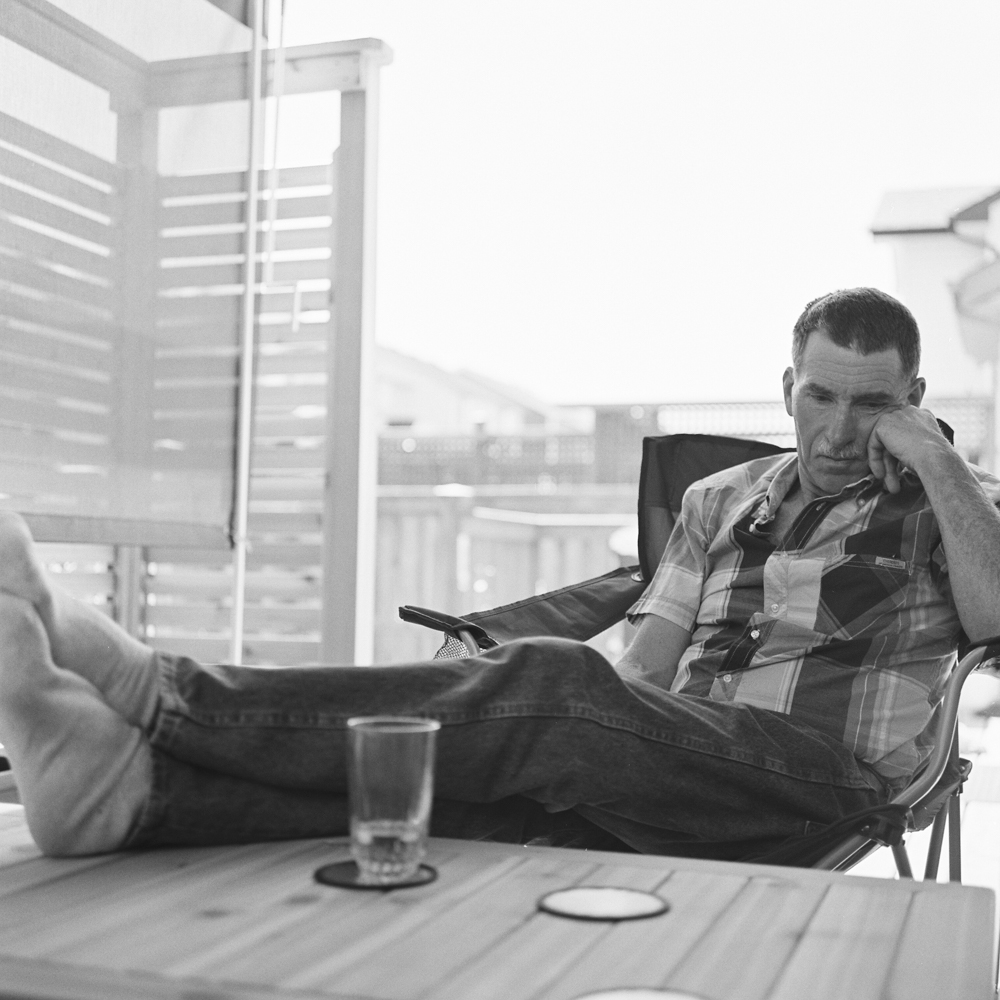 My father-in-law lounging on our deck.  Kodak Tri-X 400