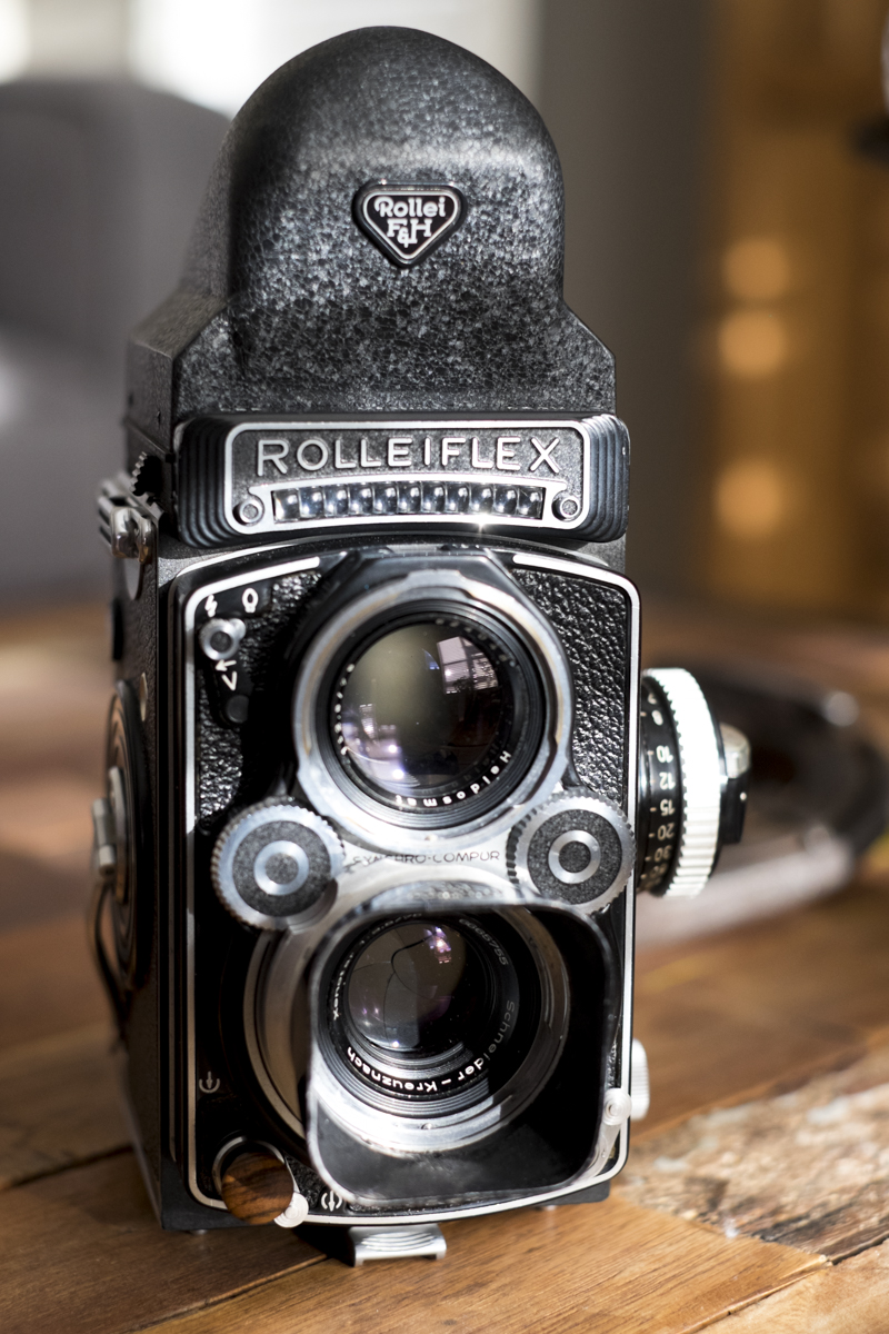 Rolleiflex with lens hood & prism viewfinder.