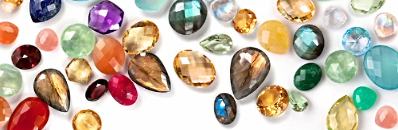 Bright colorful gemstones composition on white background.