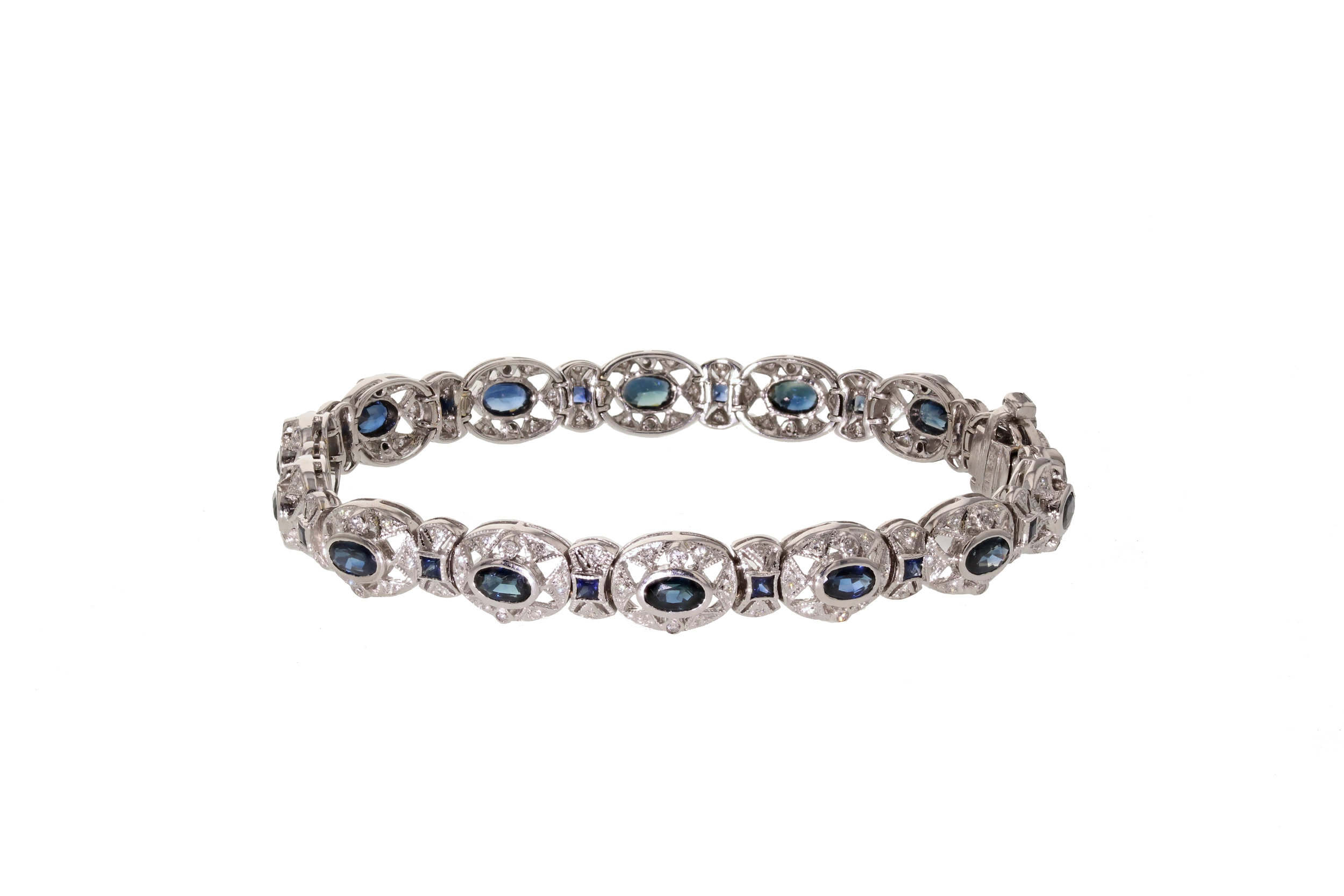 14kt White Gold Sapphire and Diamond Bracelet with 1.40 tcw diamonds and 5.18 tcw sapphires. $10,100