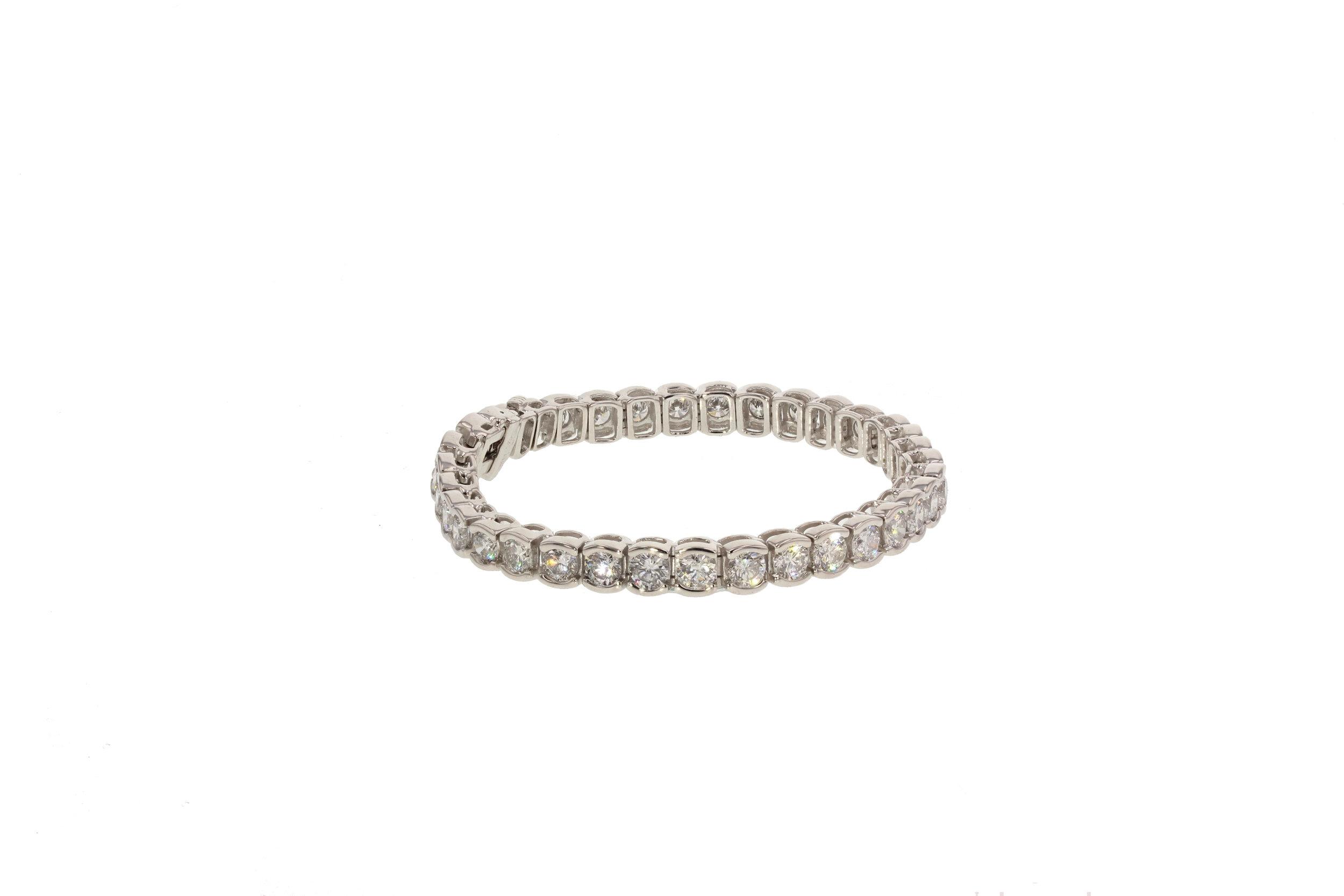 18KT White Gold Bezel Set Diamond Tennis Bracelet. 13 ctw. $45,000