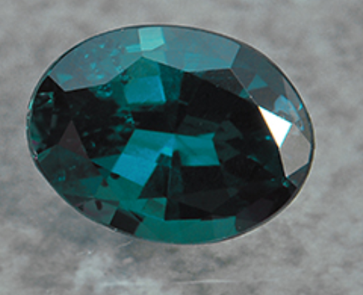 Alexandrite is emerald colored by day and rich pink-red by night.