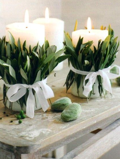Wrap some candles in foliage and tie them with white ribbon, again effortless and looks beautiful.