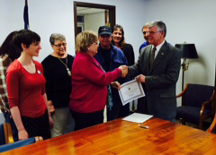 Dr. Cynthia Kolsun receives the grant award certificate from Lynn Phillips, representing Governor Tomblin.