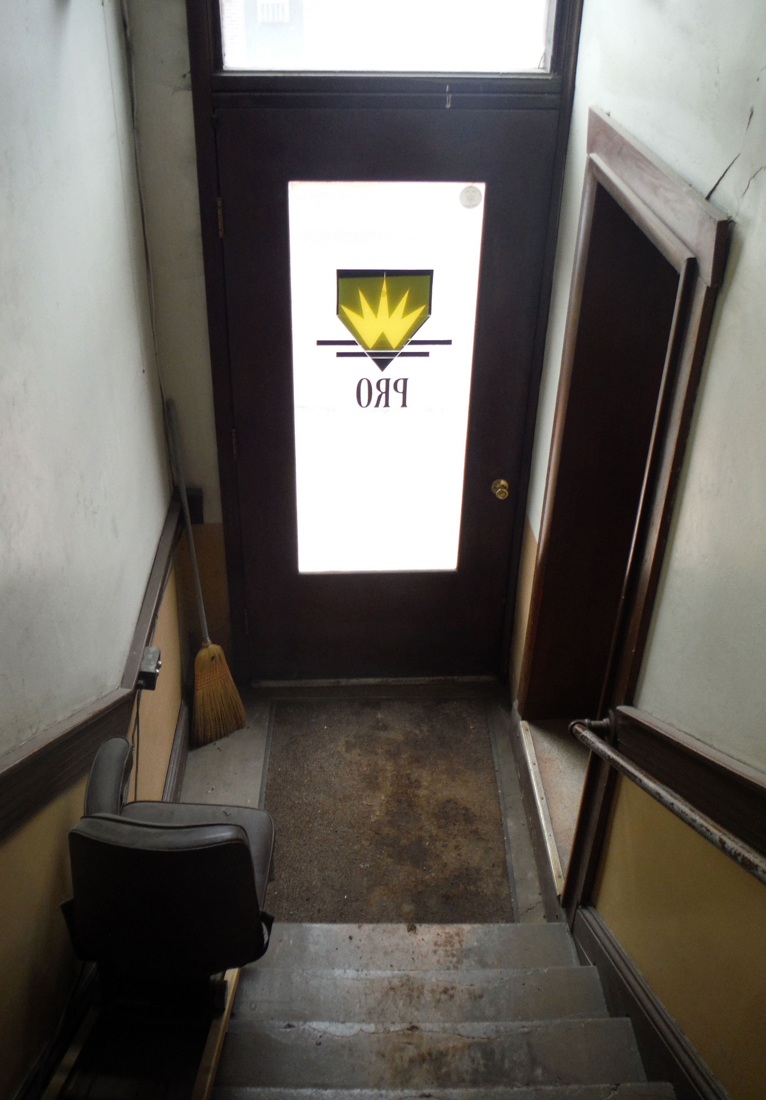 First Street entrance at the bottom of the stairs. Photo by Sydney Haltom, March 2015.
