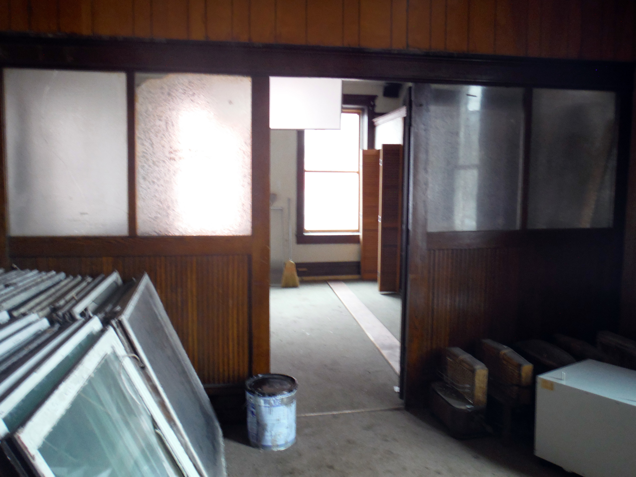Entrance to the former dentist's office. Original windows are stacked at left. Photo by Sydney Haltom, March 2015.