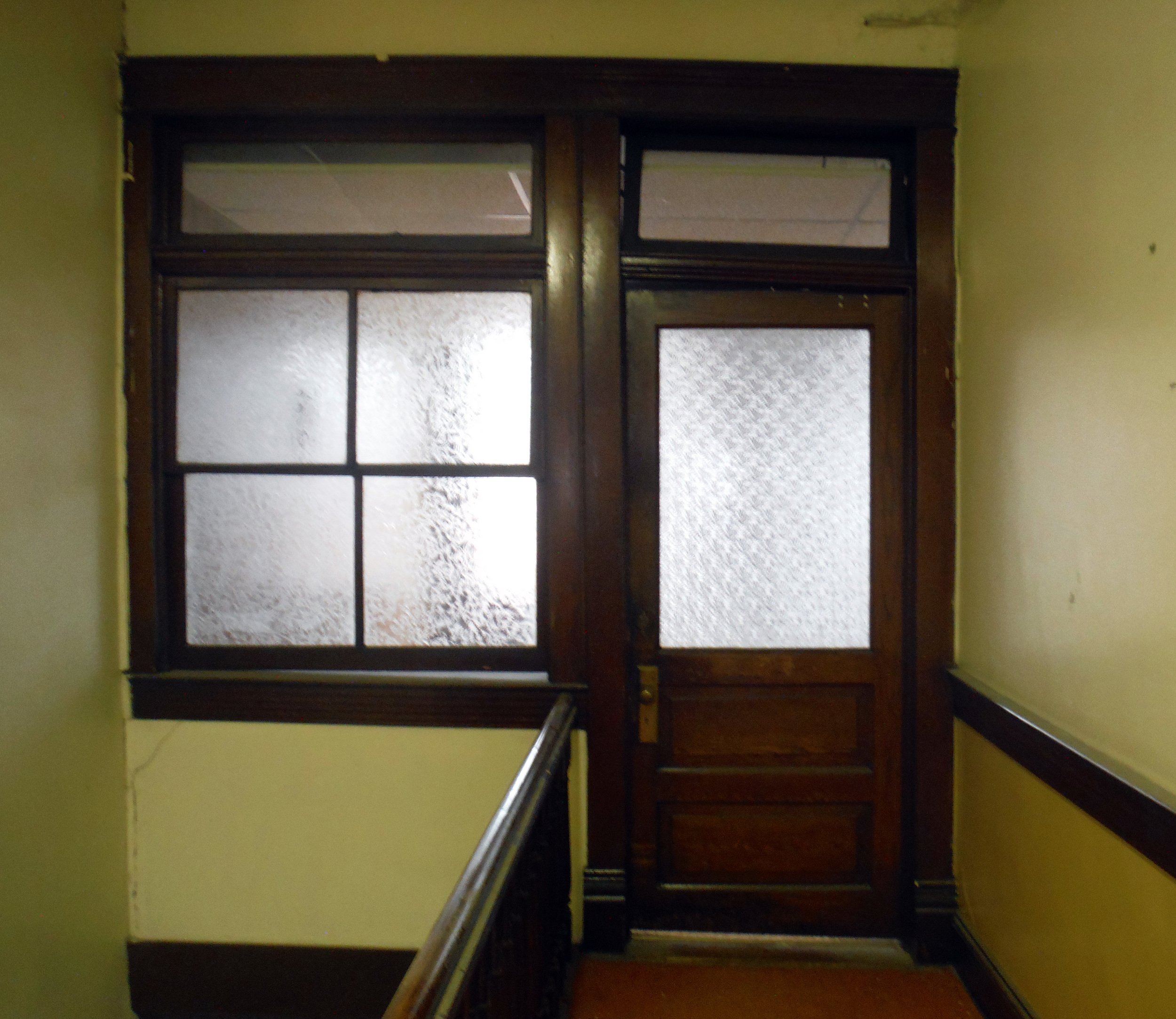 Door at the top of the stairs. Photo by Sydney Haltom, March 2015.