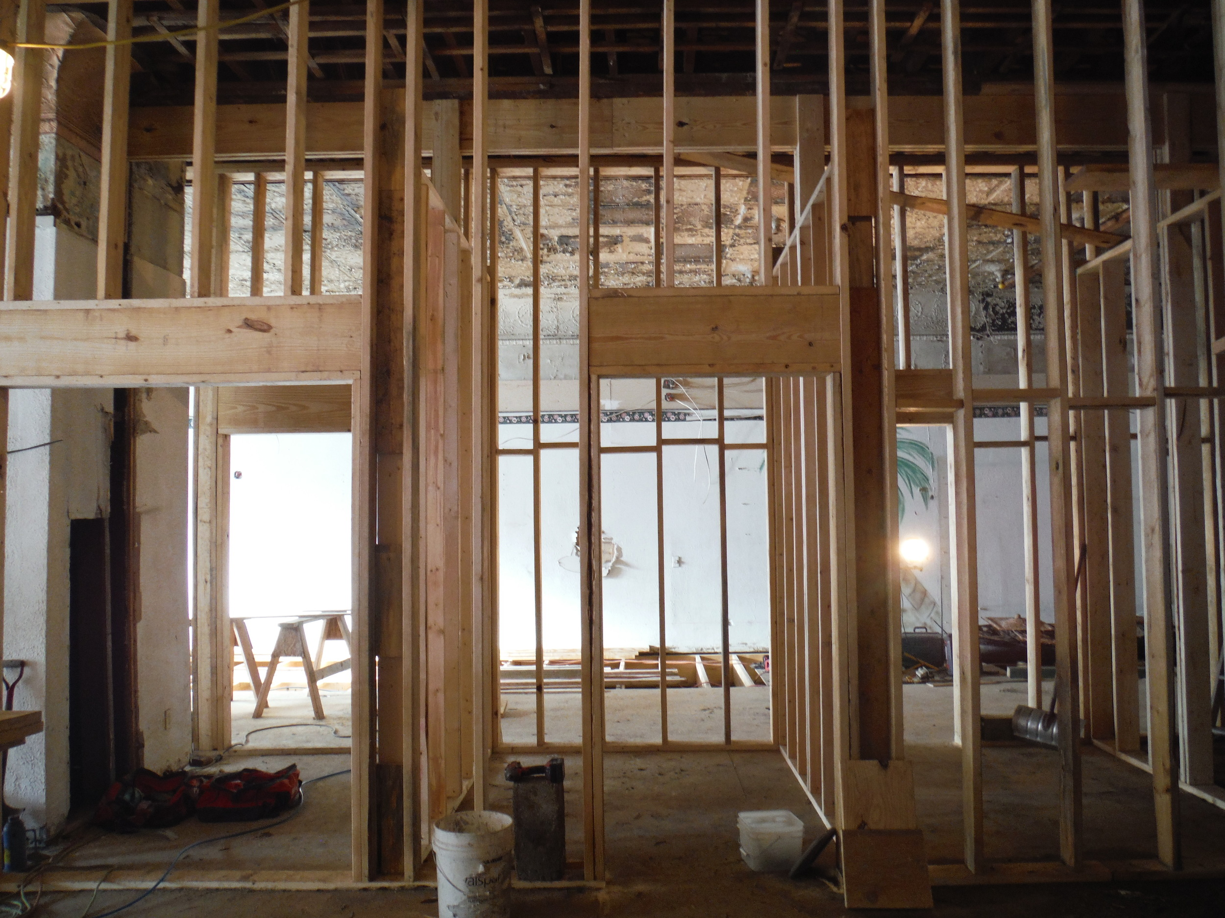 These newly-framed rooms along the center of the building are destined to become bathrooms, offices, and storage spaces.