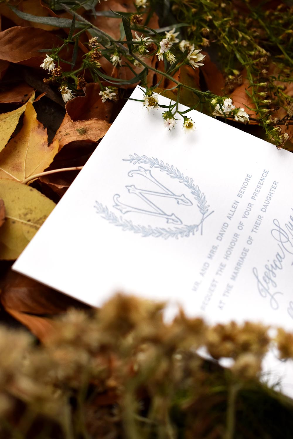 Custom emblem made for a couples invitation suite and wedding theme printed by a letterpress.