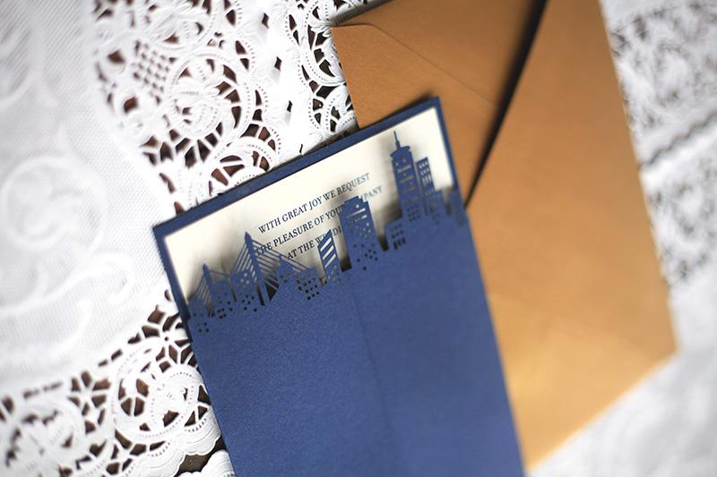 Our laser cut city skyline wedding invitation, featuring Boston, in navy blue metallic card stock.