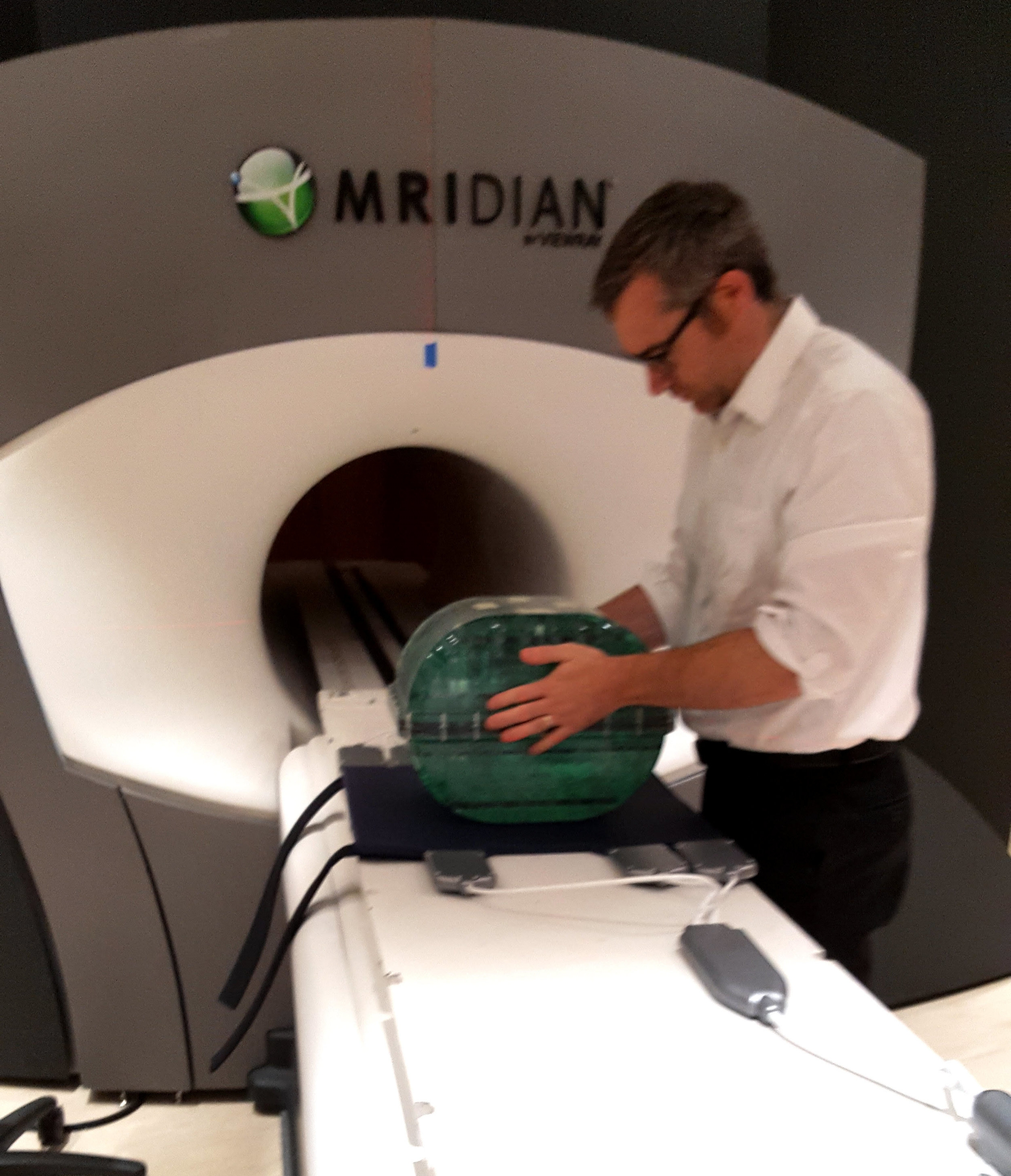 Dr. James Lamb with the Magphan® RT on the ViewRay MRIdian treatment machine.