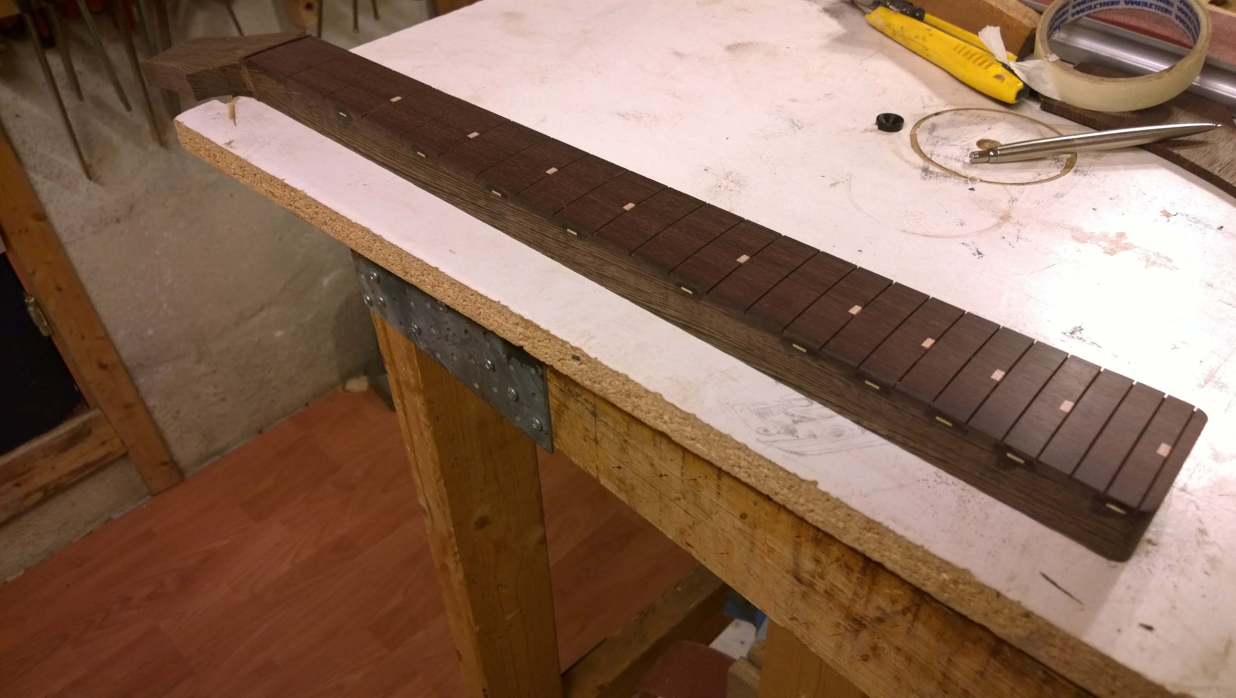 The radiused and sanded fingerboard, ready to lay the frets