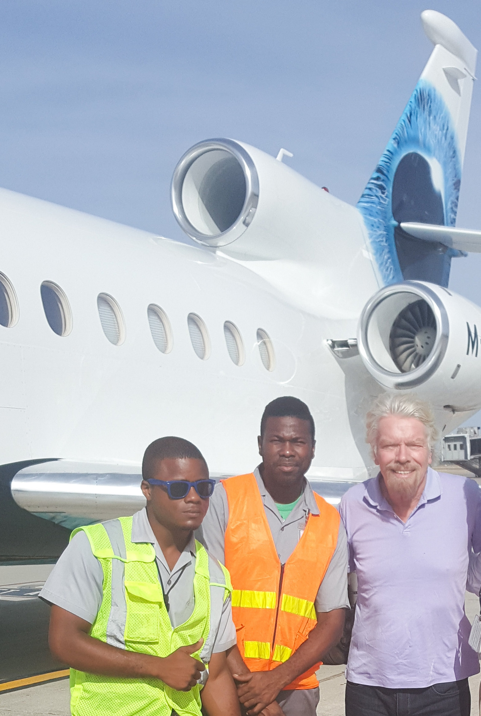 Sir Richard Branson with our team at Normal Manley Intl. Airport
