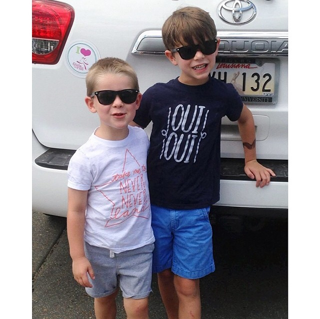 brothers ready for a fun summer day in our Oui Oui and Never Land tees