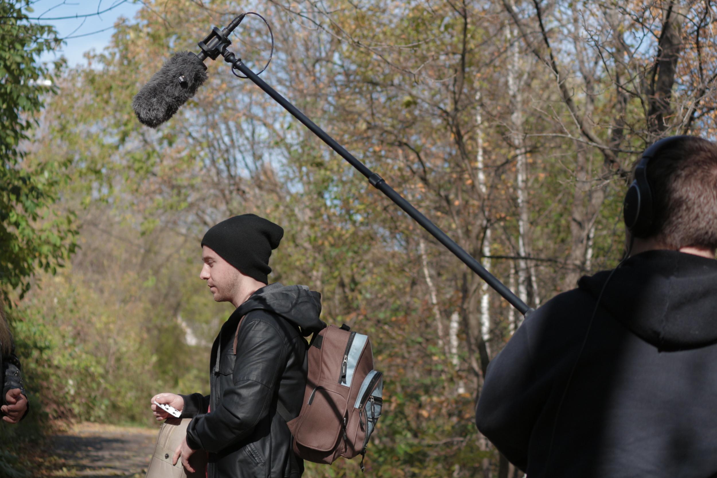 Rick Stolz prepares for a scene as Damen Krow while sound recordist Darren MacDonald readies the shotgun microphone on a boom pole.