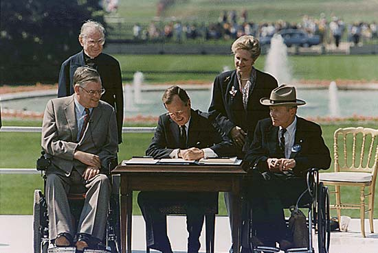 1990 - President George HW Bush is signing the Americans with Disabilities Act on the South Lawn (Encyclopedia Britannica)