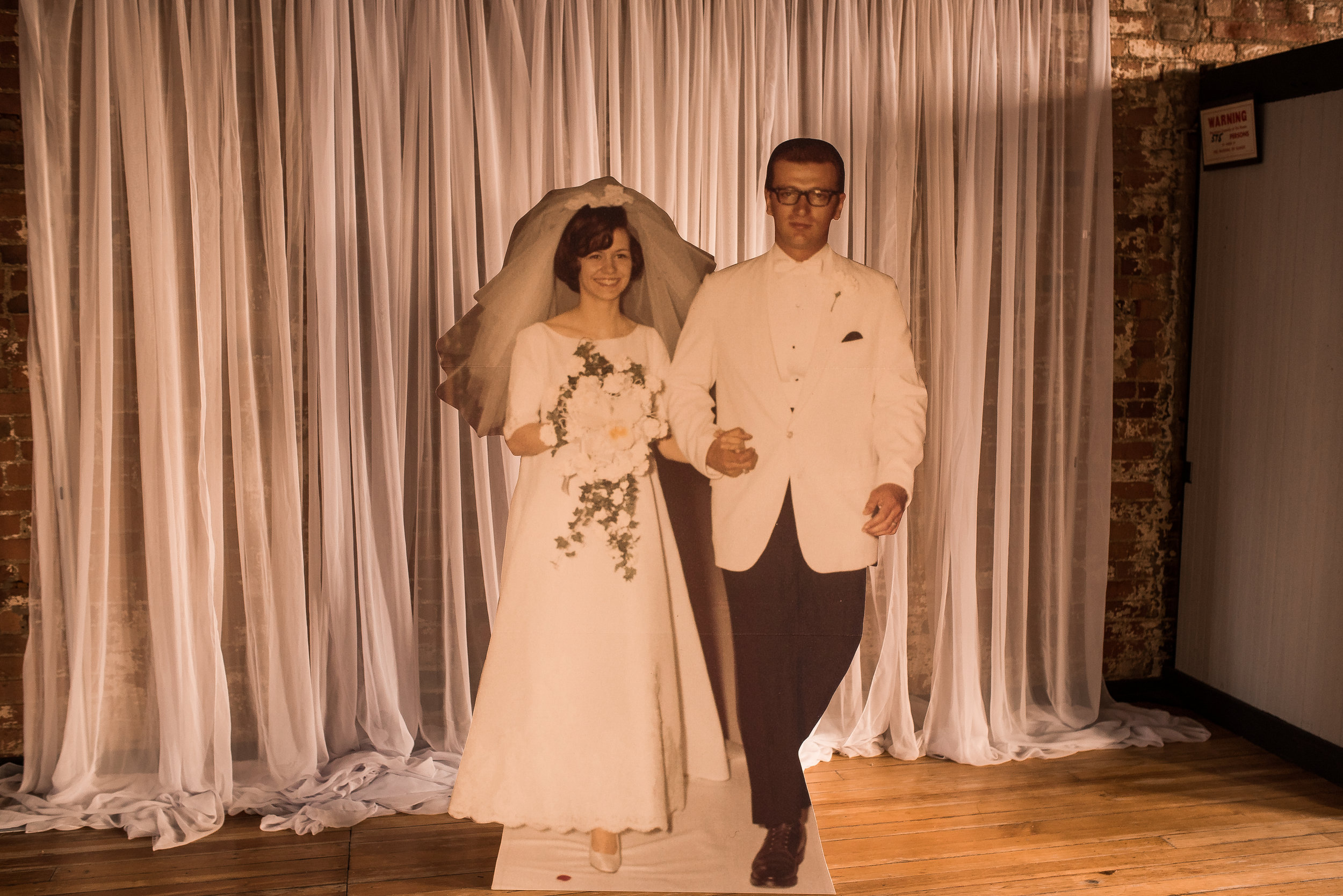 We had a wedding photo turned into a foam core, life-size cutout so guests could take a picture with the bride & groom.