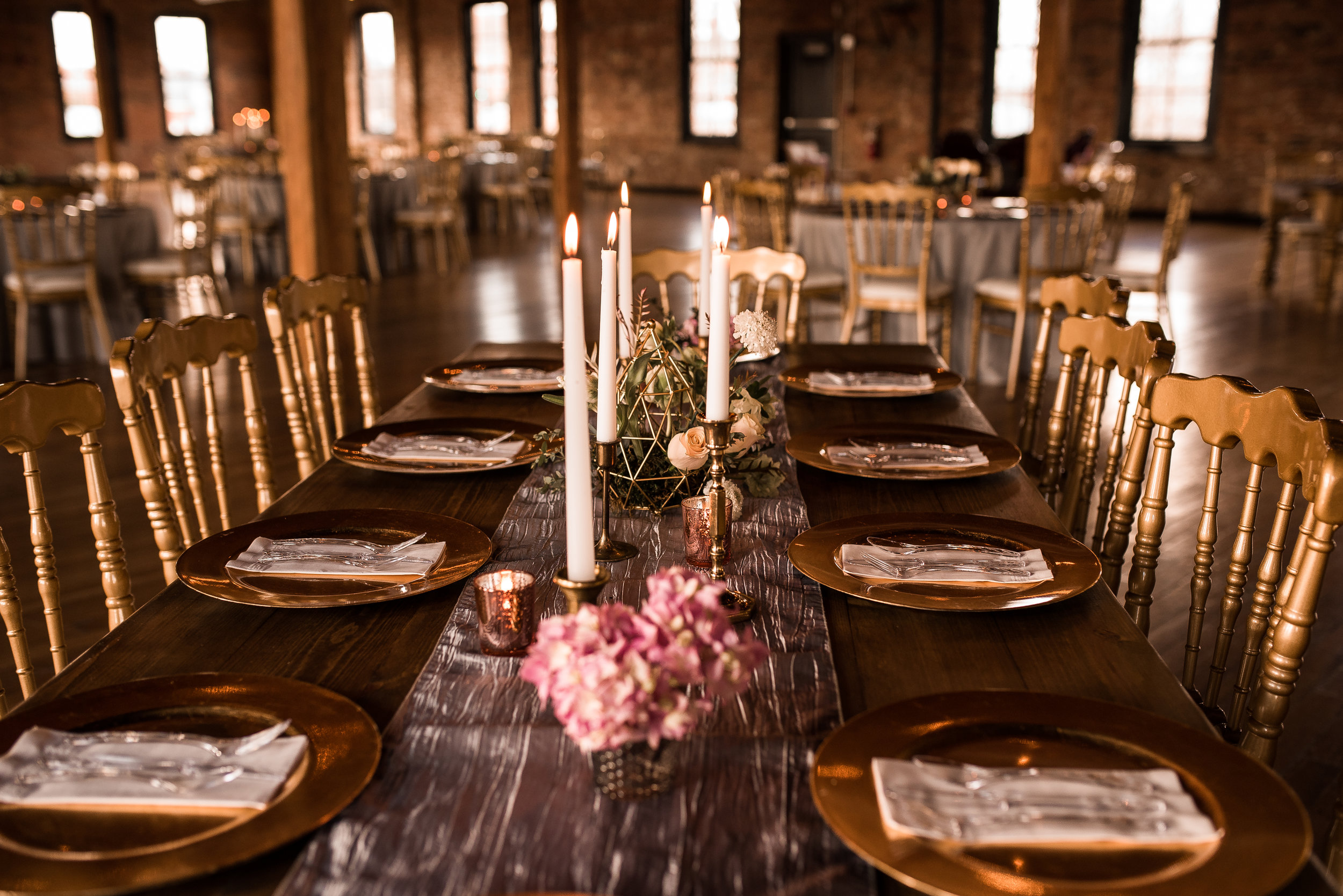 We used six brass candlesticks and four rose gold votives for each Dora Harvest Table.