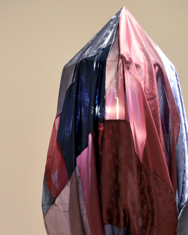 Lee_Joo Young_3_Shaman the Hardest Night_Leftover Hanbok (traditional Korean garment) fabric, drying rack, string, wire, spray paint, metal, light_6x2x2 feet_Sculpture_2014.jpg