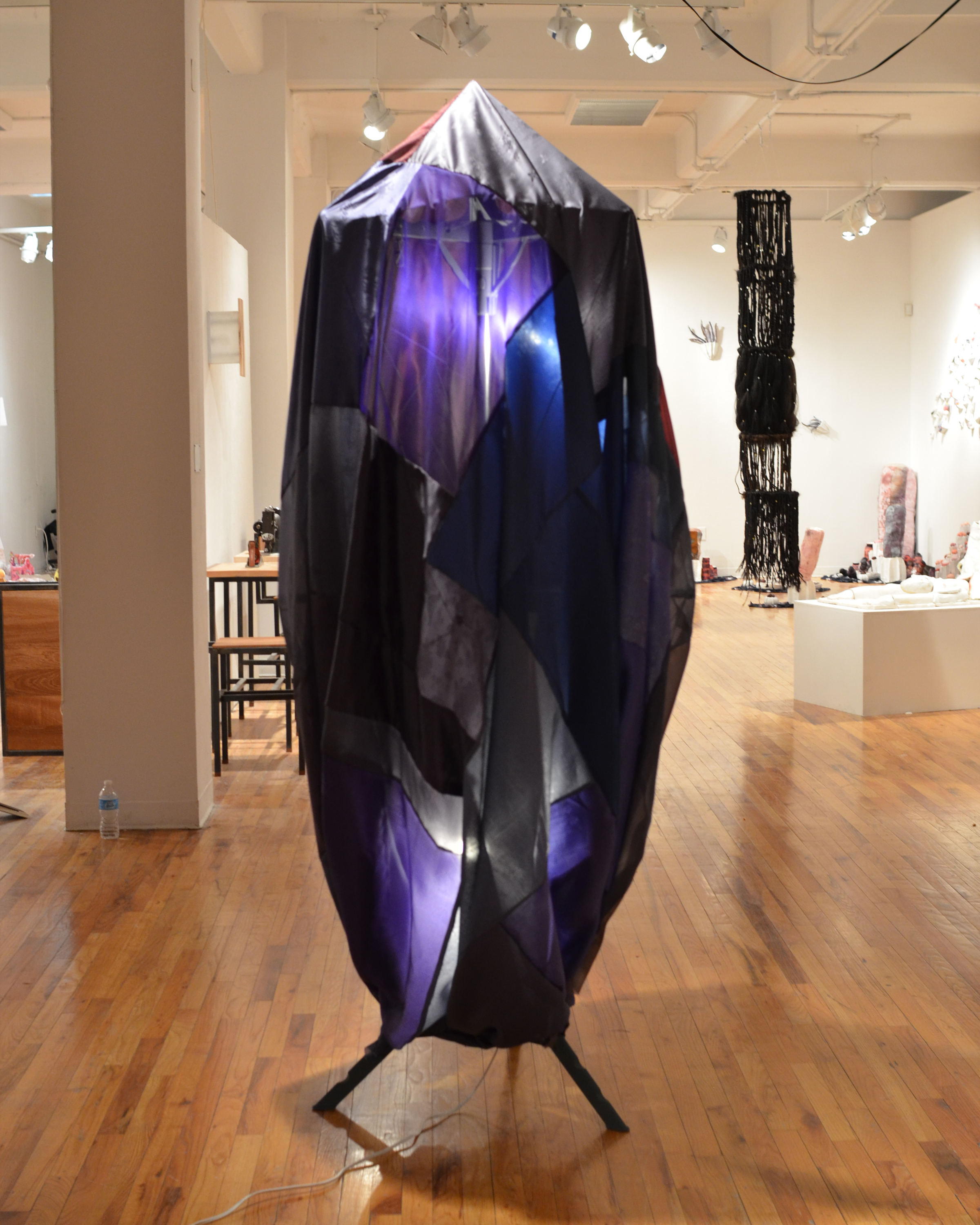 Lee_Joo Young_2_Shaman the Hardest Night_Leftover Hanbok (traditional Korean garment) fabric, drying rack, string, wire, spray paint, metal, light_6x2x2 feet_Sculpture_2014.jpg