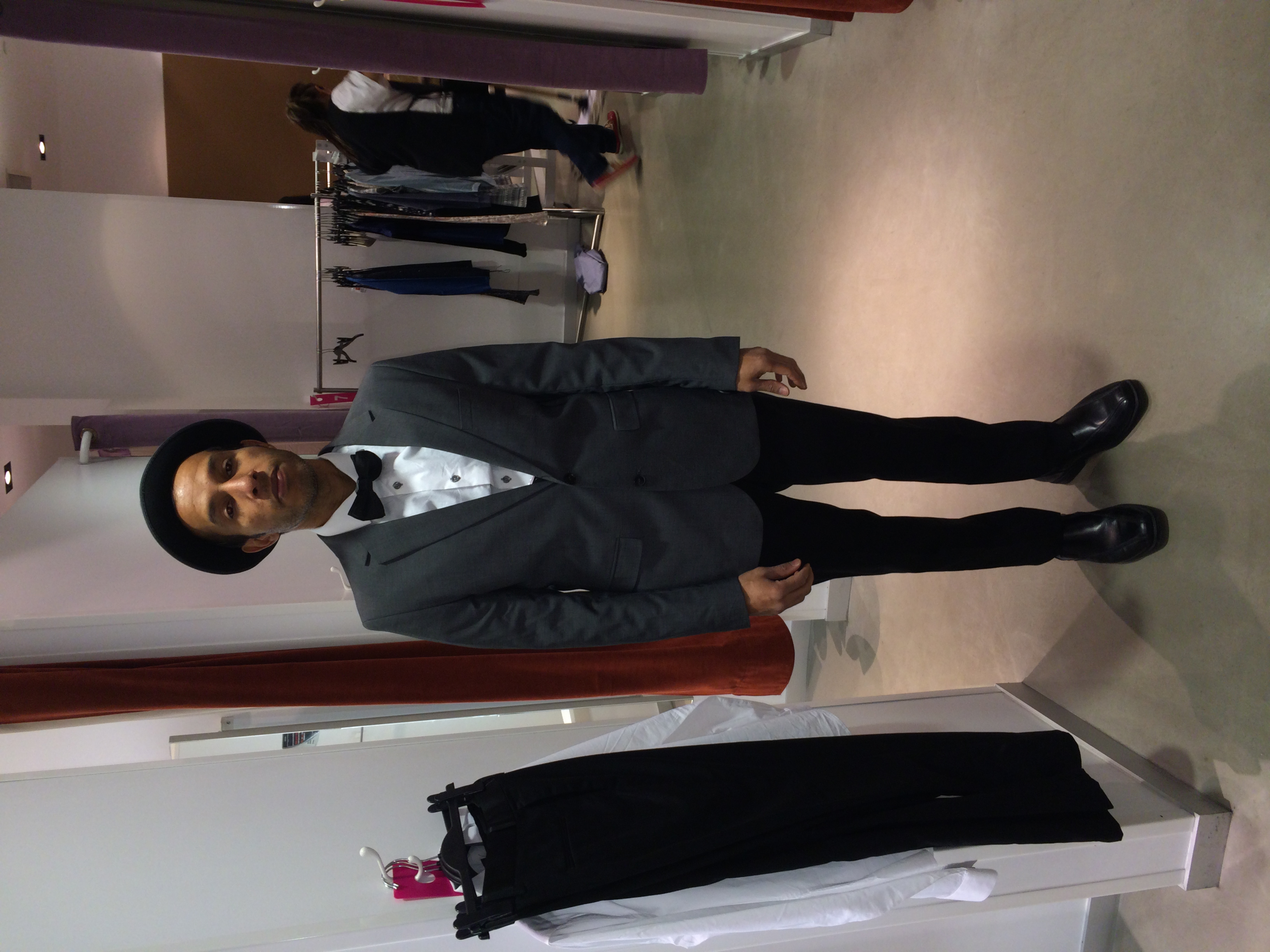 Marti Christopher trying on some suit options for the video shoot.