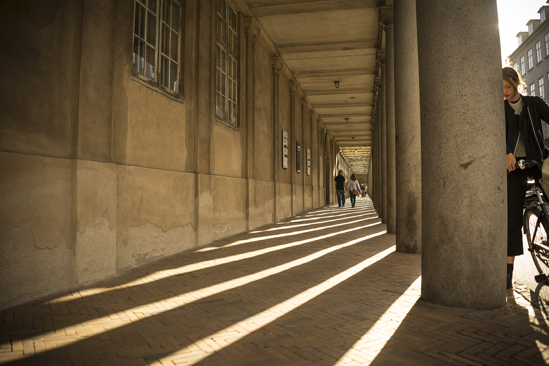 Sunlight Through Columns with Girl Pondering.jpg