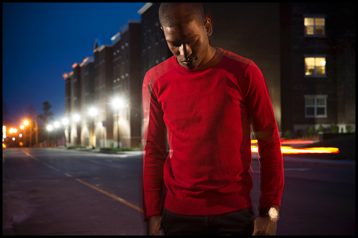 """Miami senior Nick Gilyard poses for a portrait along Kentucky street where a few weeks ago he was walking up the street and a vehicle drove by, shouted a racial slur and threw a cup of ice at him. """"I watch movies about racism and I've read about it,"""" said Gilyard on Sunday, April 13, 2014. """"You think you have a handle on it but it makes me feel different having something like that happen to me."""" Photo by Brian Powers"""