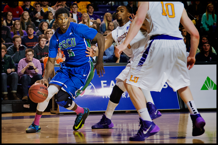 Florida Gulf Coast University's Jamail Jones tries to dribble around Lipscomb University's Khion Sankey (0) and Talbott Denny (10) during their game at Lipscomb University in Nashville, TN on Thursday, February 27, 2014. FGCU would go on to loose 93-71. Photos by Brian Powers