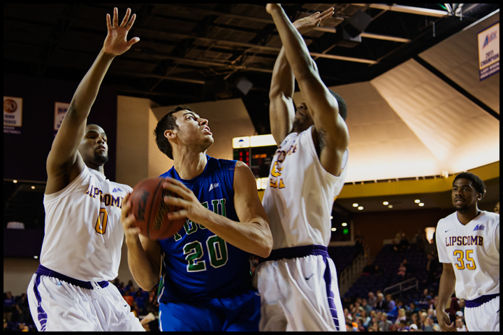 Florida Gulf Coast University's Chase Fieler tries to get a shot off  between Lipscomb University's Khion Sankey, left, and Malcolm Smith, right, during their game in Nashville, TN on Thursday, February 27, 2014. FGCU would go on to loose 93-71. Photos by Brian Powers