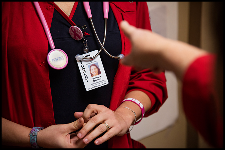 WKU non-traditional student Barbara Morrow, 32 of Bowling Green, gets instruction from her teacher Robin Madison before she begins her clincals with nurse Tonja Wilt of Bowling Green at the Medical Center on Tuesday, February 18, 2014. Photos by Brian Powers