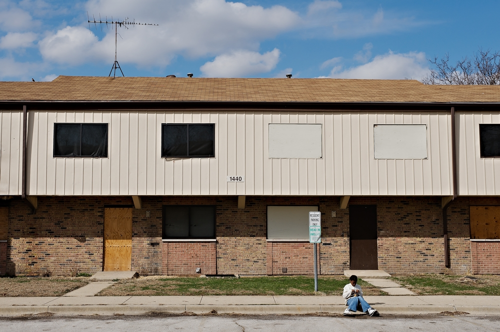 Boarded up buildings are a common site as more and more families move out of the complex breaking up friend and family ties that go back many years.