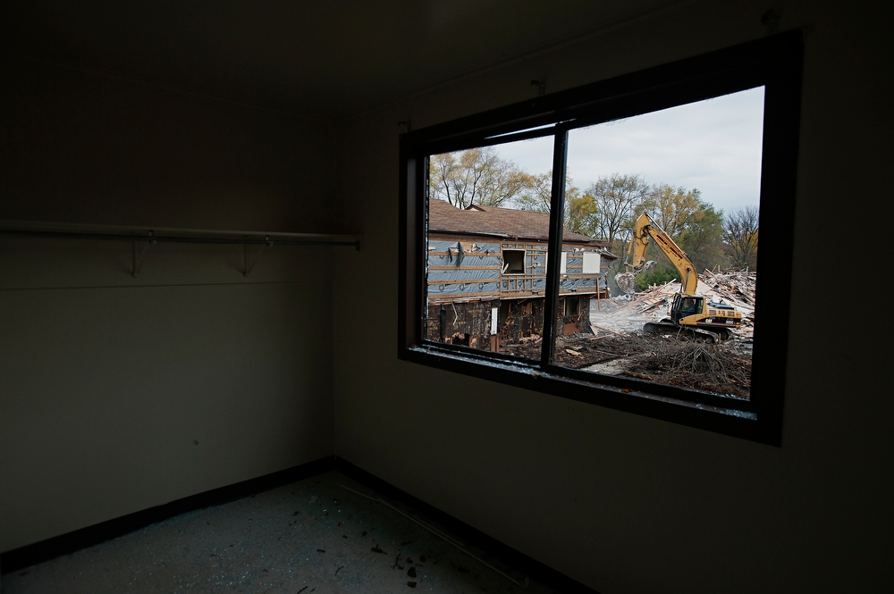 Bulldozers begin the demolition of homes at Jericho Circle almost three years after the city began relocating residents.