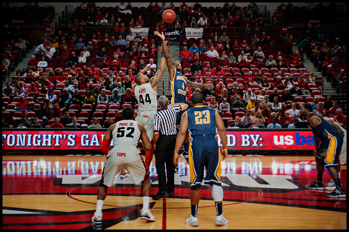 WKU's George Fant tips off with Murray State's Jarvis Williams, right, at E.A. Diddle Arena on Saturday, December 21, 2013. Western would go on to win their sixth straight home game 71-64. Photos by Brian Powers