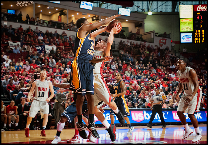 WKU's Chris Harrison-Docks tries to shoot against Murray State's Jeffery Moss at E.A. Diddle Arena on Saturday, December 21, 2013. Western would go on to win their sixth straight home game 71-64. Photos by Brian Powers