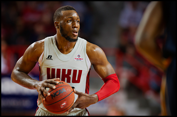 WKU's T.J. Price had a big second half to help push the Hilltoppers over Murray State 71-64 at E.A. Diddle Arena on Saturday, December 21, 2013. Photos by Brian Powers