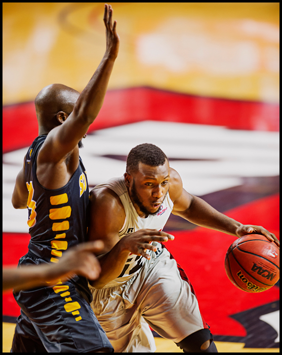 WKU's T.J. Price drives around Southern Miss' Jerrold Brooks at E.A. Diddle Arena on Wednesday, December 18, 2013.  The Hilltoppers would go on to win 68-65. Photos by Brian Powers