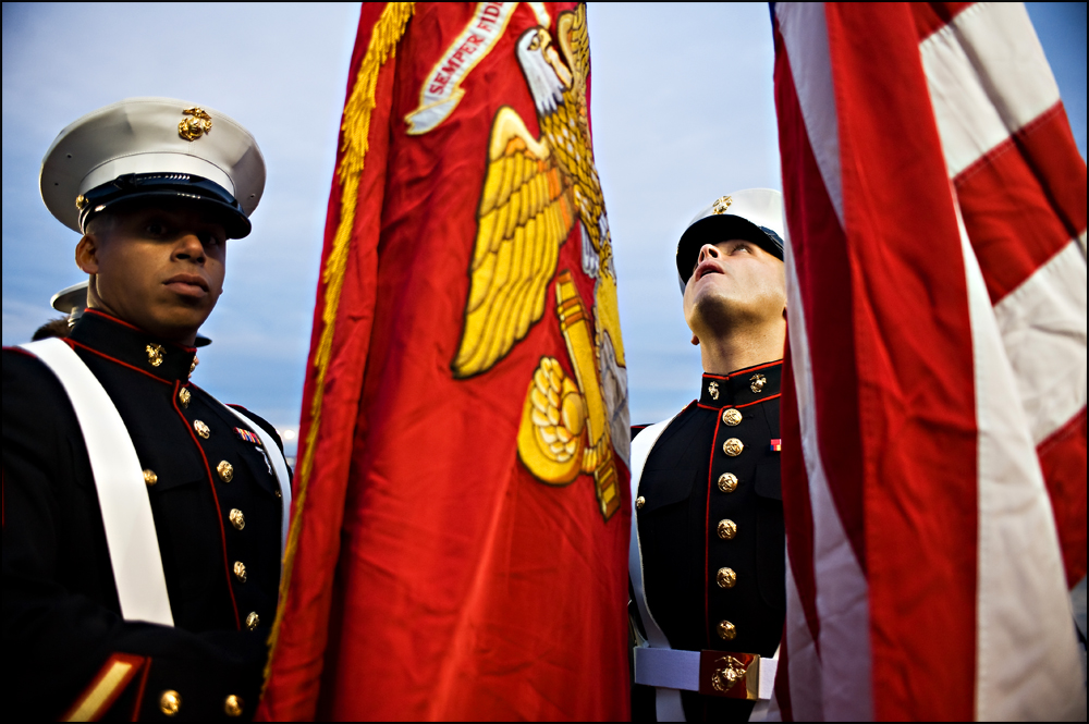 Marine Color Guards Sgt. Javier Sandoval, right, of Chicago and Sgt. Juan Sanchez, left, of Chicago, hold the colors before presenting them at the NASCAR Camping World Truck Series at Chicagoland Speedway in Joliet, Ill on Friday, September 16, 2011.   Brian Powers~Sun-Times Media