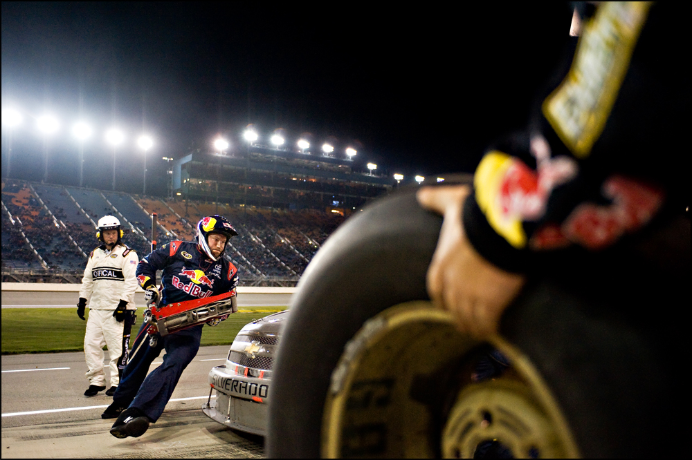 The pit crew works on changing all four wheels of Cole Whitt's Chevy during the NASCAR Camping World Truck Series at Chicagoland Speedway in Joliet, Ill on Friday, September 16, 2011.   Brian Powers~Sun-Times Media