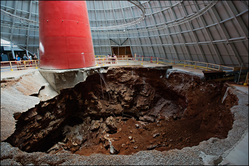 On February 12, 2014 a 33 foot deep, 62 foot wide sinkhole opened up inside the National Corvette Museum's Skydome in Bowling Green, KY. The hole swallowed eight Corvettes with it which are now on display in the condition they were removed from the hole. Board members are meeting on Wednesday, June 25, 2014 to discuss what the future will be for the sinkhole at the museum. Photo by Brian Powers