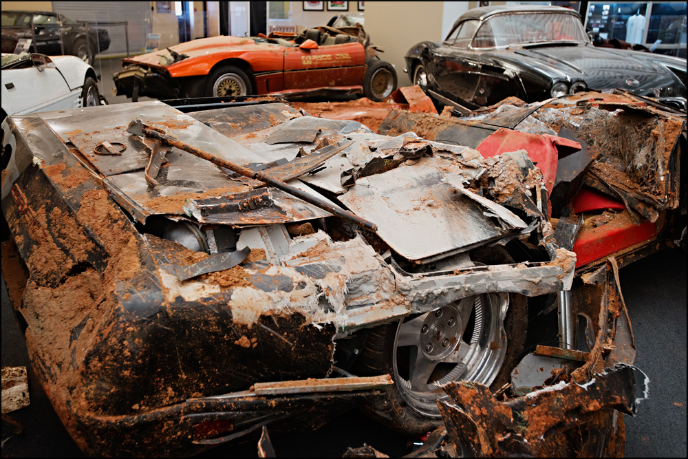 A ZR1 Spyder Corvette that was on display in the Skydome at the National Corvette Museum now sits on display in the condition that it was removed from the sinkhole in on Wednesday, June 25, 2014. Photo by Brian Powers