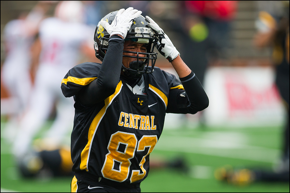 Central High School's Raiden Anderson reacts after Central lost 7-14 to Belfry during the KHSAA Commonwealth Gridiron Bowl at Western Kentucky University on Friday, December 5, 2014. Photo by Brian Powers