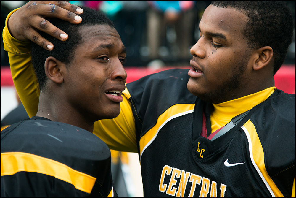 Central High School's Nate Young, left, is comforted by teammates after loosing 7-14 to Belfry at the KHSAA Commonwealth Gridiron Bowl championships at Western Kentucky University on Friday, December 5, 2014. Photo by Brian Powers