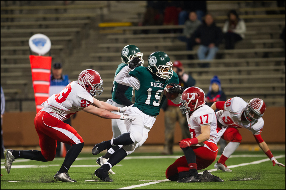 Trinity's Donald Brooks runs to the end zone for the last of his three touchdowns in the first half of the Shamrocks game against Dixie Heights during their KHSAA Commonwealth Gridiron Bowl game at Western Kentucky University in Bowling Green, KY on Saturday, December 6, 2014. Photo by Brian Powers