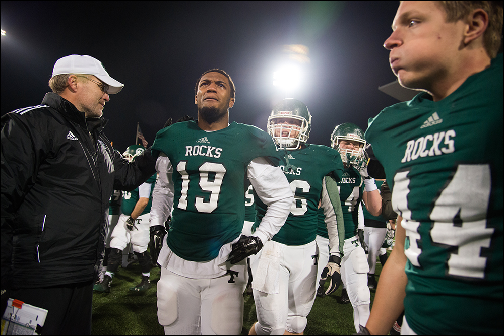Trinity's Donald Brooks (19) looks up at the scoreboard after the Shamrocks defeated Dixie Heights 47-14 during their KHSAA Commonwealth Gridiron Bowl game at Western Kentucky University in Bowling Green, KY on Saturday, December 6, 2014. Photo by Brian Powers