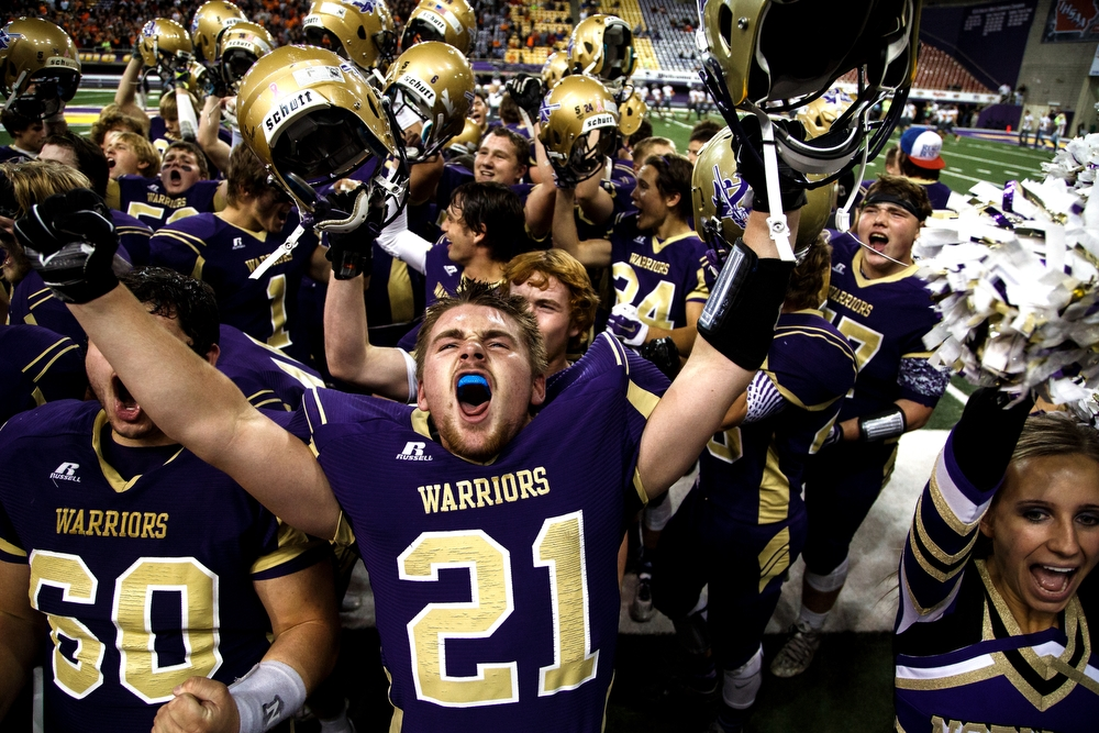 Norwalk's Zachary Cook celebrates with his team after they defeated Sergeant Bluff-Luton during their semifinal game at the UNI dome on Thursday, November 12, 2015 in Cedar Falls.